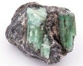 Rough emerald of 264 grams on matrix.