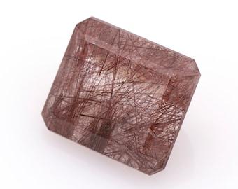 Emerald-cut natural rutilated quartz, weight: 22.85 ct.