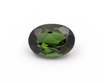 Deep green tourmaline of 0.90 ct. Measurements: 7.10 x 5.06 x 3.44 mm.  Oval-cut.