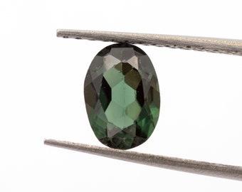 Deep green tourmaline of 0.90 ct. Measurements: 7.05 x 5.00 x 3.15 mm.  Oval-cut.