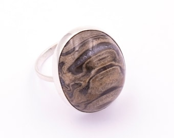 925 silver ring with fossilized wood - Measurements gem 24 x 20.1 mm. - Weight: 7.91 grams.