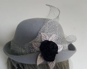 1920's Flapper-styled Grey Cloche Hat with Silver Lame and Black Satin Flower Roses trim