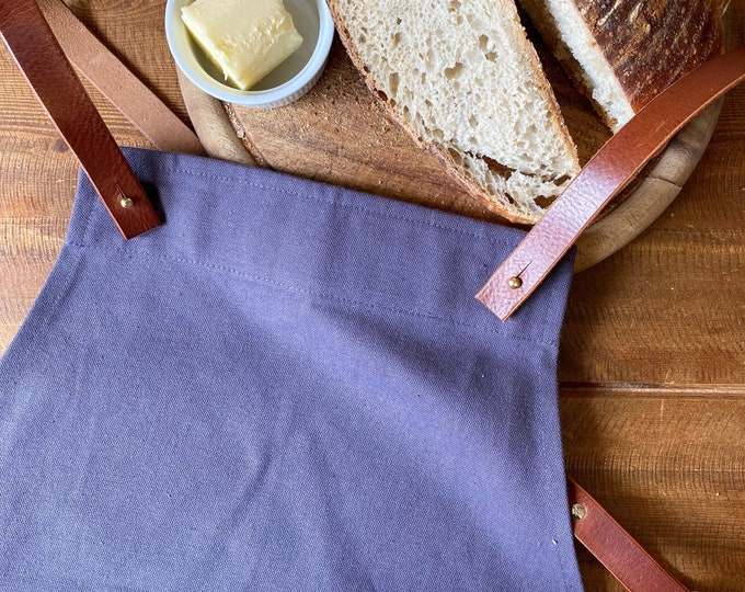 Featured listing image: Organic Cotton Canvas and Leather Cross-Back Apron in Purple Grey