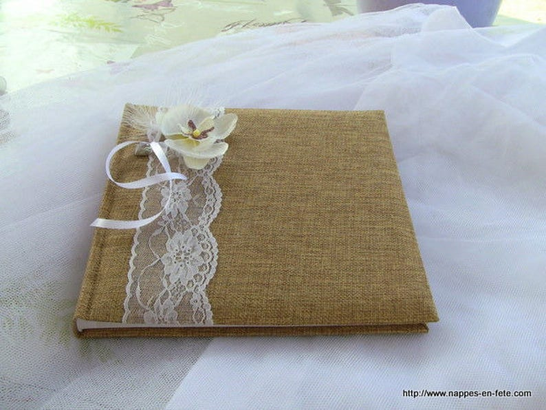 Guest book decorated with burlap lace and an orchid