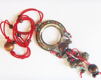 Ethnic necklace red blue beads and wire.