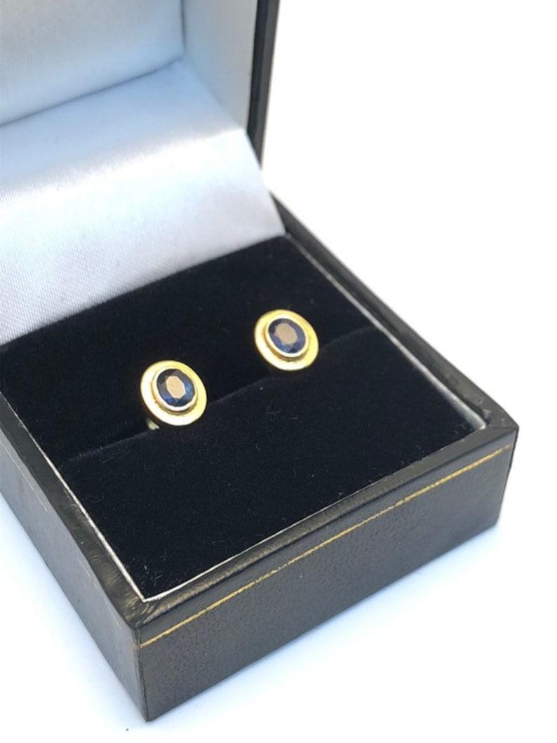 18 carat gold blue sapphire stud earrings 8 millimetres long