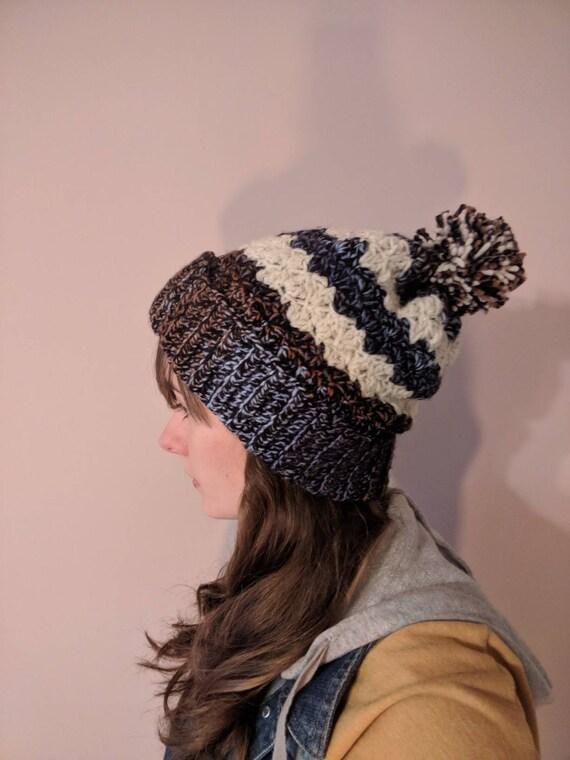 9235dd8b1c2 Slouchy Pom Pom Hat Crocheted Blue Brown Black and Beige Aran
