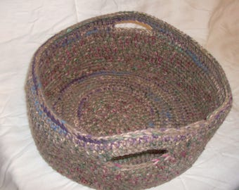 Large brown and multicolored crocheted basket
