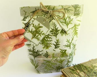 Botanical packaging handmade gift bag for Christmas holiday with green branches