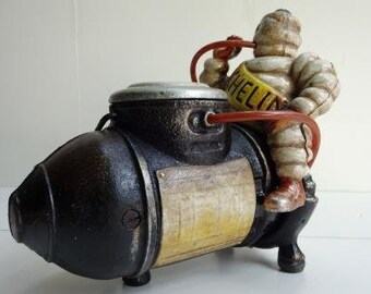 Vintage Style Cast Iron Michelin Man on Air Compressor Figure