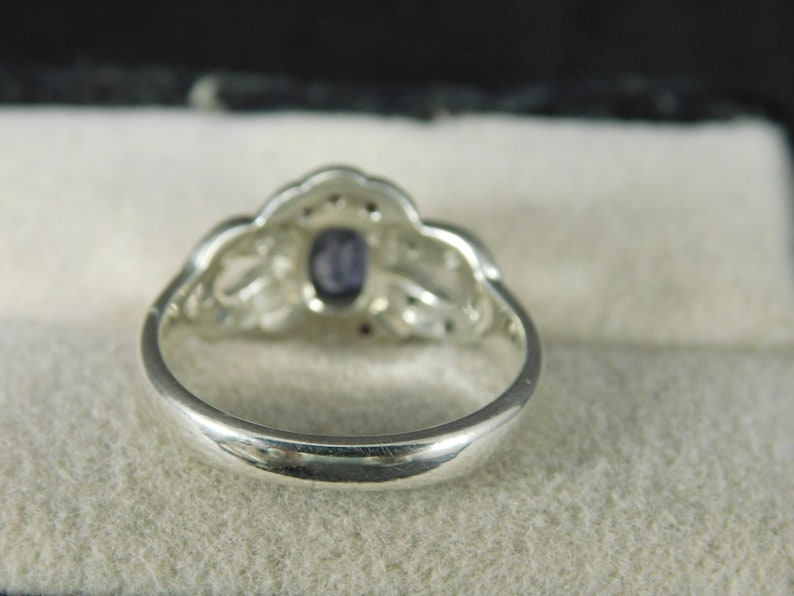Oval Tanzanite Ring with Ruby and Sapphire in a Halo Style Sterling Silver Setting 0.95 ct