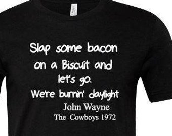John Wayne Quotes ,Slap some Bacon on a Biscuit and let's go we're burnin' daylight , Westerns , Western Movie Quotes, The Duke , The Pilgra