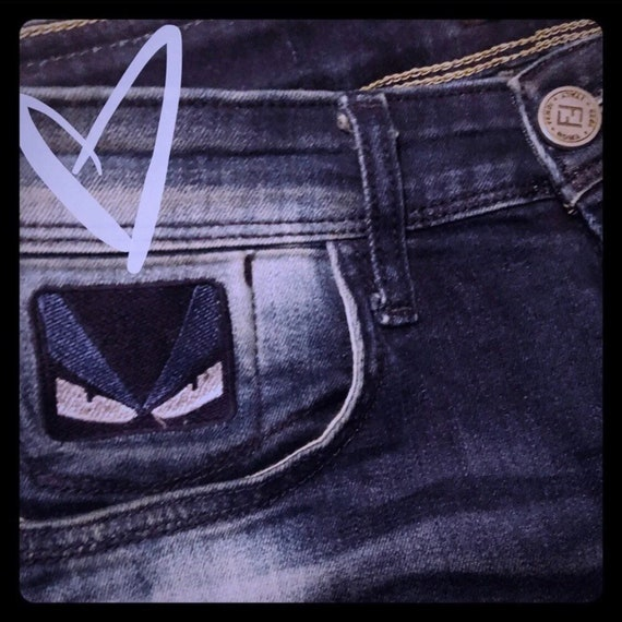 Vintage Fendi Distressed Monster Logo Skinny Jeans
