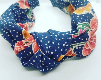 Reclaimed, sustainable headband in royal navy on chiffon with white polka dot and floral pattern.