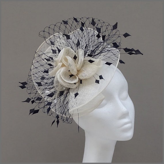 ea6ca34ed3b Ivory and navy disc fascinator with netting and feathers for