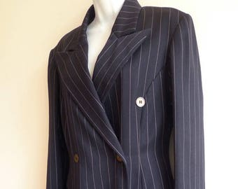 Ozbek dark navy pin striped suit with embroidered cuff name tag