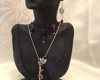 Necklace with Ruby Red beads and Silver Chains and Ear Rings.