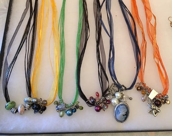 Necklaces. Hand Made.Ribbon with Charms and Beads.