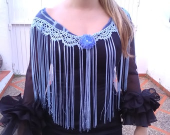 Mantoncillo of flamenco in blue lead, is made with gauze fabric and topped with fringes made of crochet of the same color.
