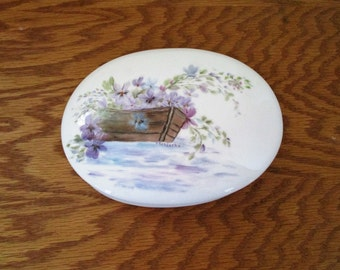 Violets In A Boat OnThe Water