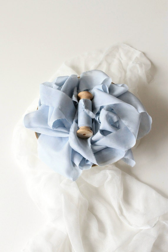 wedding invitations naturally-dyed wedding styling Dusty blue hand dyed silk ribbon on wooden spool Boho bouquet