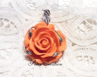 "Orange ""ROSE"" pendant with silver foliage"