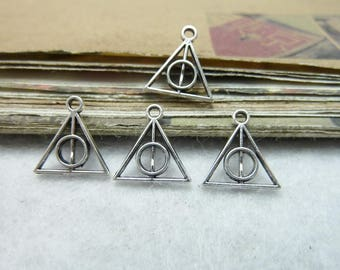 6 small triangle shape charms pendants and included round symbol object magical relic of death