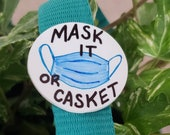 Mask It or Casket acrylic pin