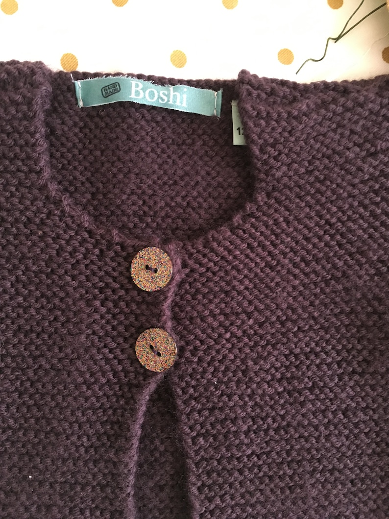 Baby cardigan made of worsted polyamide and short sleeves plum color