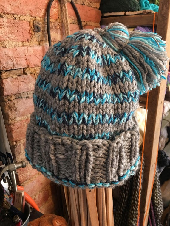 Hand knitted striped winter hat in stripes of your color choice. Tassel detail. Adult
