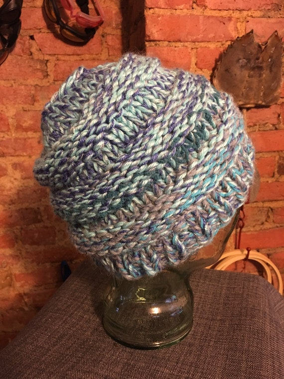 Pontail messy bun handknitted hat beanie toque cream and mixed blues