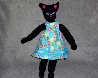 Cat Doll with Four Dresses