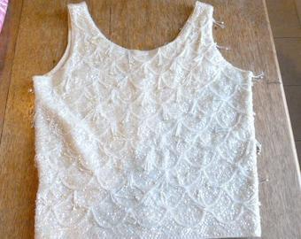 Beaded, sleeveless shell circa 1950s