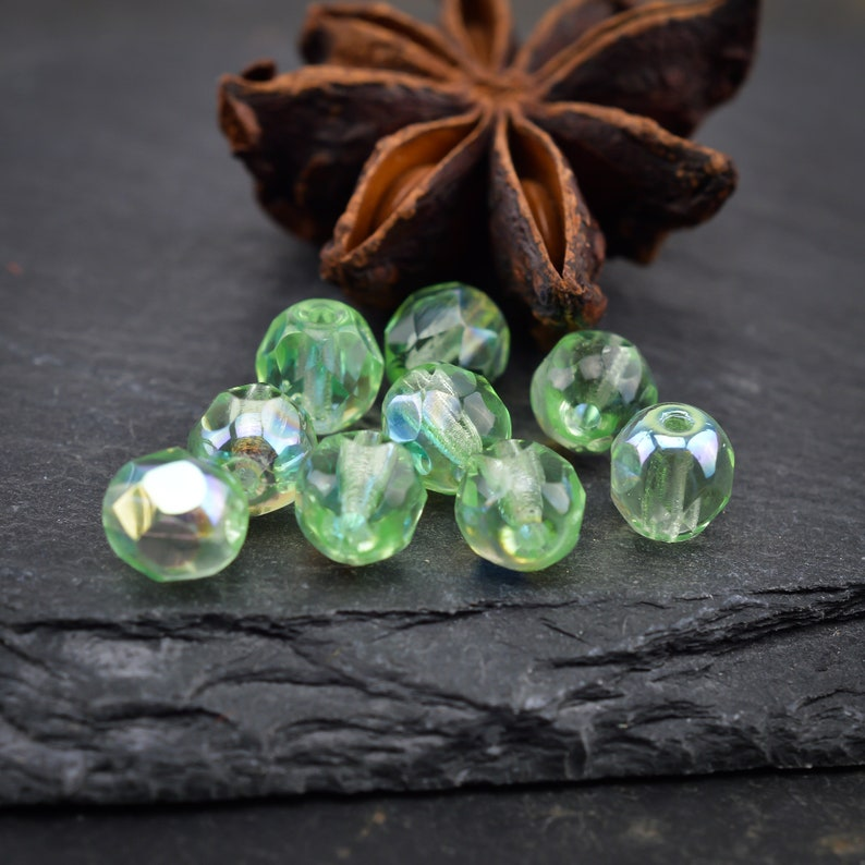 21-04 25 Bohemian pearls with pale green iridescent facets polished over fire 6mm FACETTED CZECH PERLES