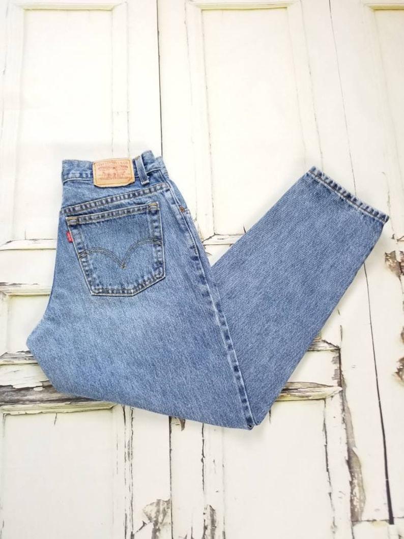 387aad4b9d0d4b Vintage Levi's 550 High Waisted Tapered leg Medium Blue | Etsy