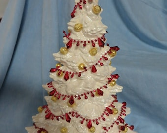 White Christmas tree, decorated with red