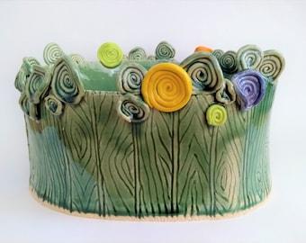 Ceramic sculpture art, handbuilt, flowers behind fence, vessel, fruit bowl, modern home deco, unique artsy gift, green orange purple yellow