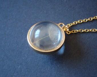 Gold tone dandelion dome necklace