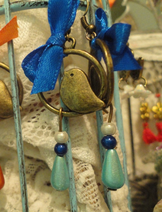 Bronze bird, iridescent pearls and satin ribbon earrings
