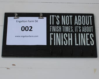 Race Bib and Medals for Marathon Finish Lines Sign