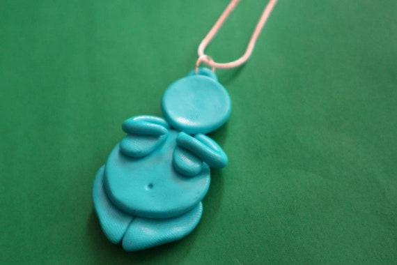 Turquoise venus of Willendorf pendant - body positive feminist symbol and lucky charm