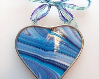 Handmade swirly glass heart shaped decorative hanging.