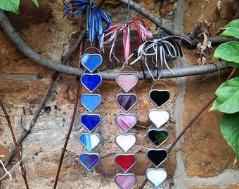 Handmade stained glass heart hangings.