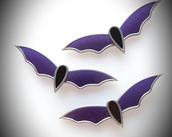 Handmade stained glass purple bats.