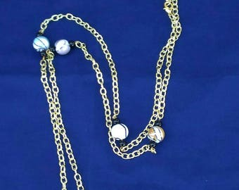Necklace made of chain and glass beads, white, black, blue, tan, grey and yellow orange.  Original  Handmade one of a kind