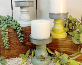Modern farmhouses are taking the world by storm. If you want to decorate your living room with modern farmhouse living room decor, this is for you! These metal and wood candle holders will accent any room.