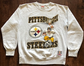 cdc76a635 Vintage Nutmeg Mills 1994 Pittsburgh Steelers cartoon Football player  Pullover Sweater