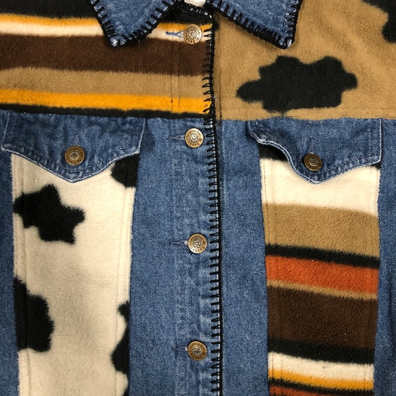 Cute Blue jean jacket with cow print details