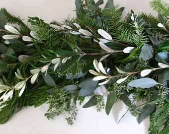 fresh christmas holiday garland with cedar fir eucalyptus olive