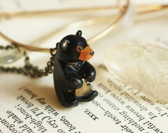 Black bear necklace with a heart in his paws, bear cub jewelry, Bronze star charm bear totem spirit animal, bear cub pendant black bear art